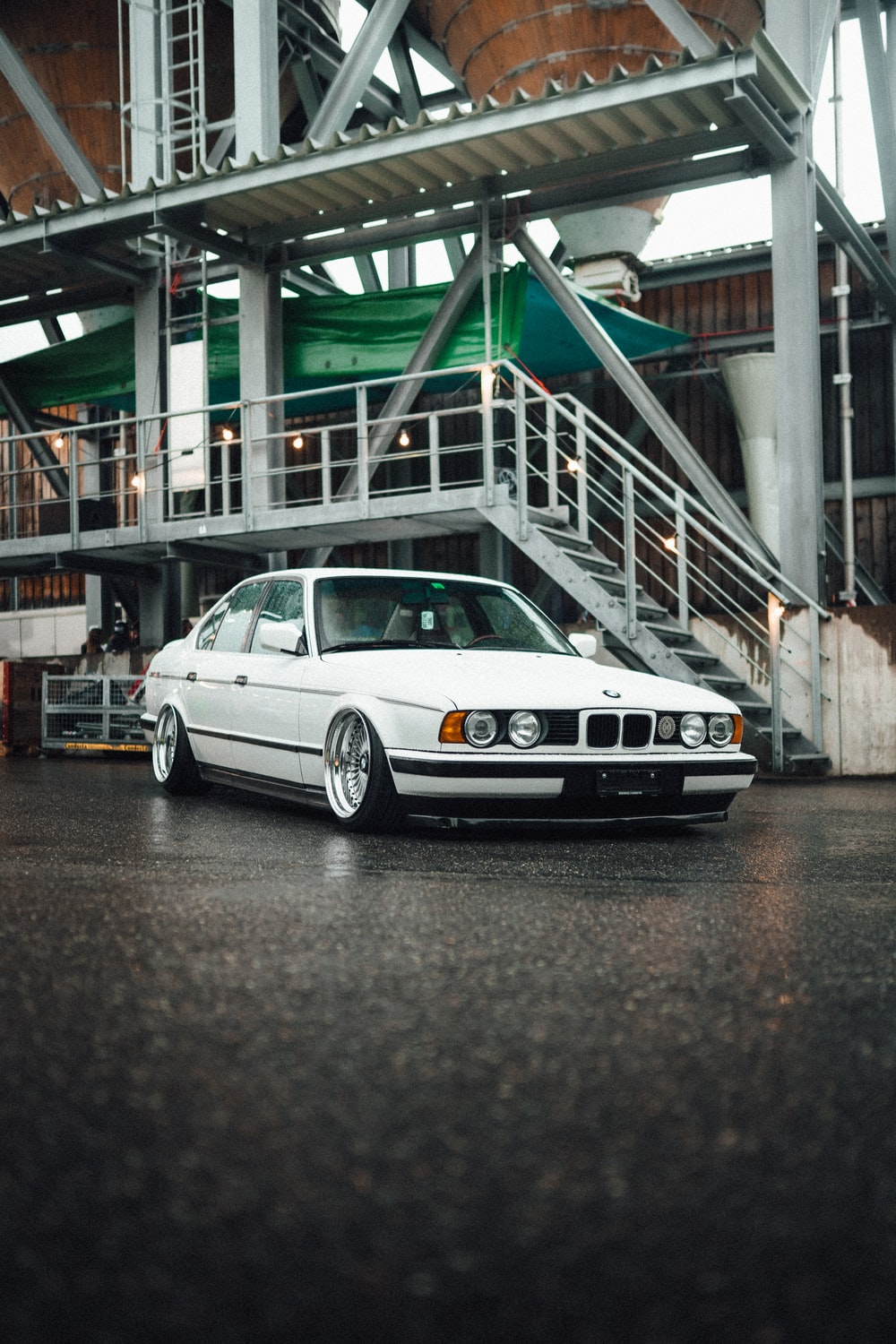 white bmw m 3 coupe parked on gray concrete pavement