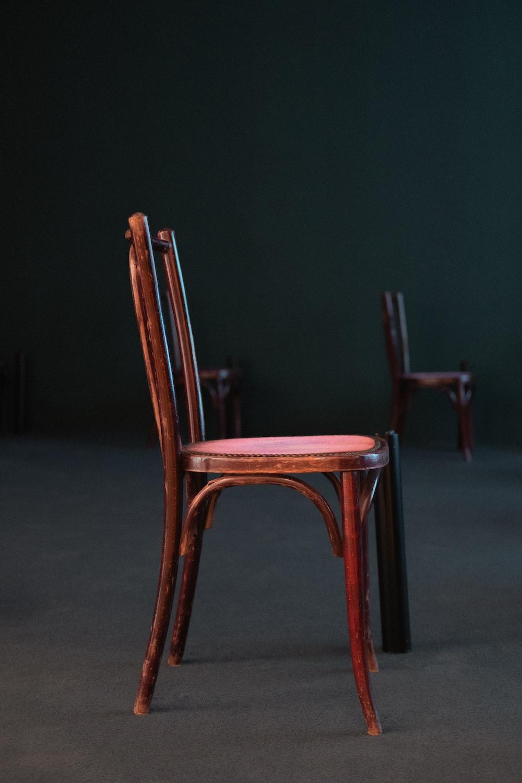 brown wooden chair on gray floor