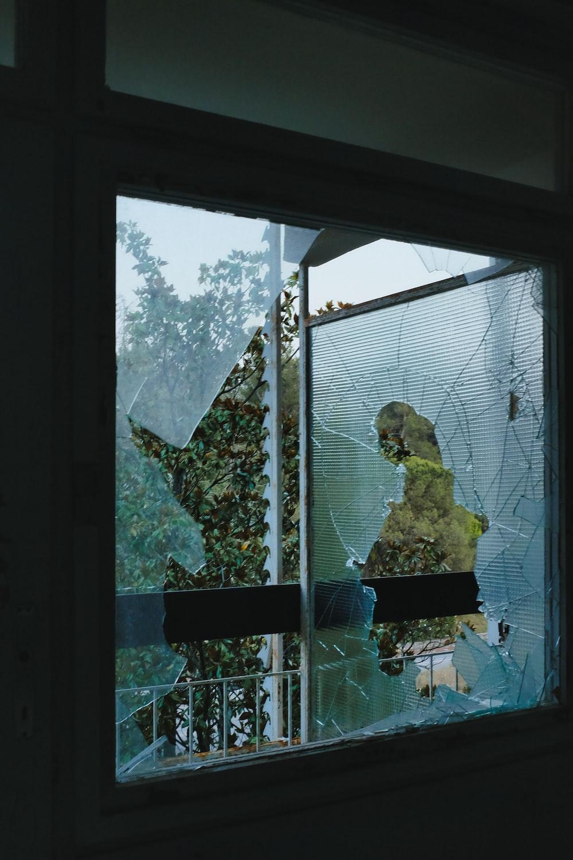 woman in yellow dress standing near window