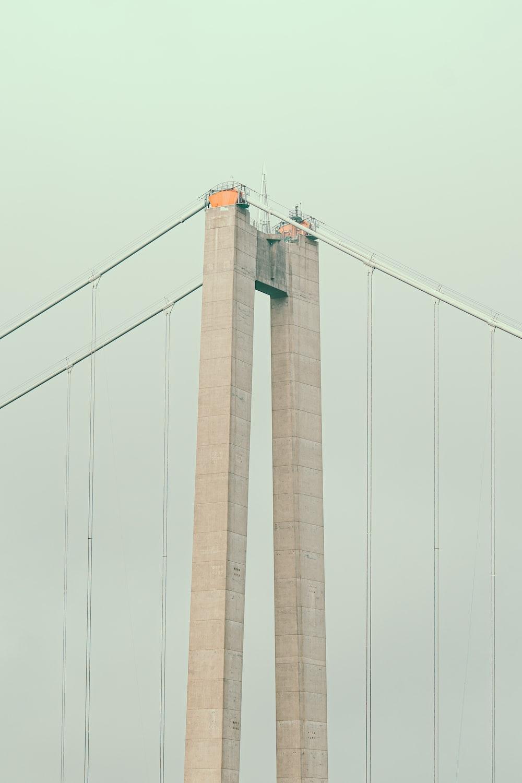 brown concrete bridge under white sky during daytime