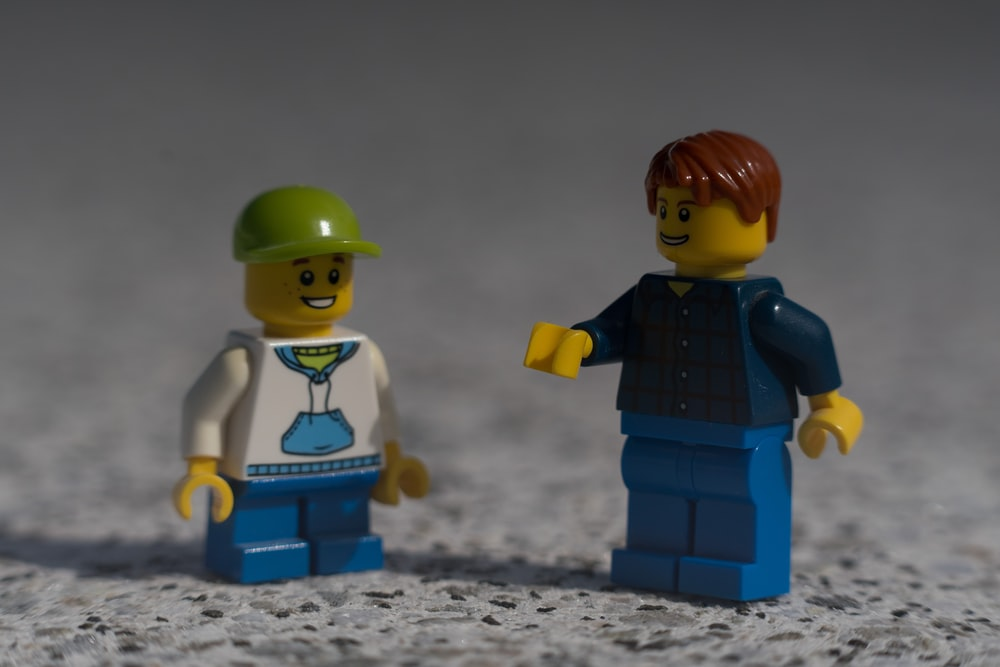 boy in blue and black vest lego