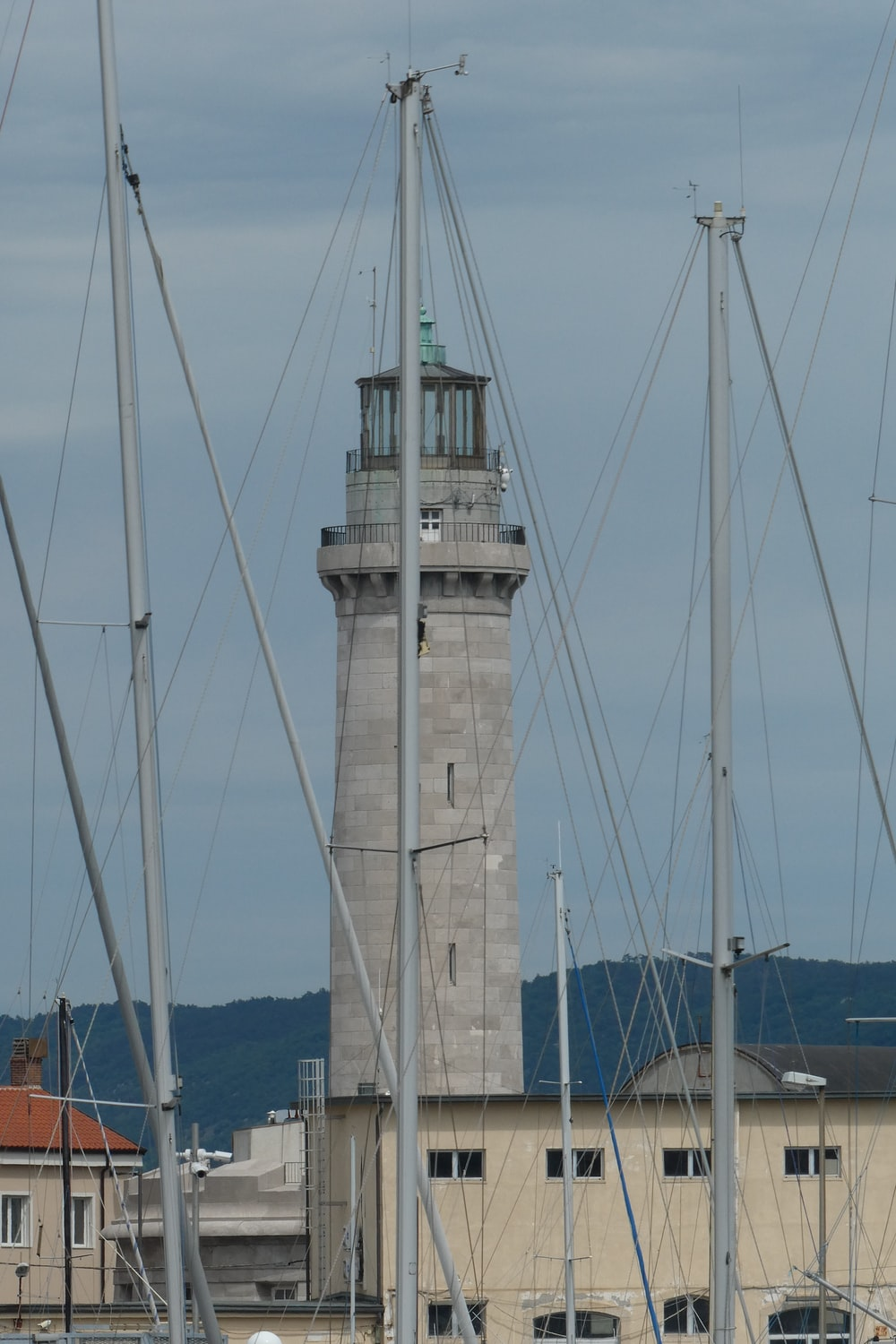 brown and white concrete lighthouse during daytime