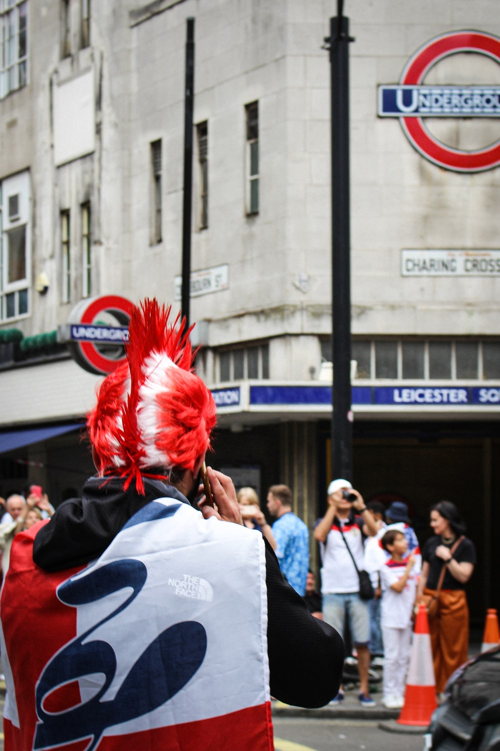 people in white shirt and red wig standing on street during daytime