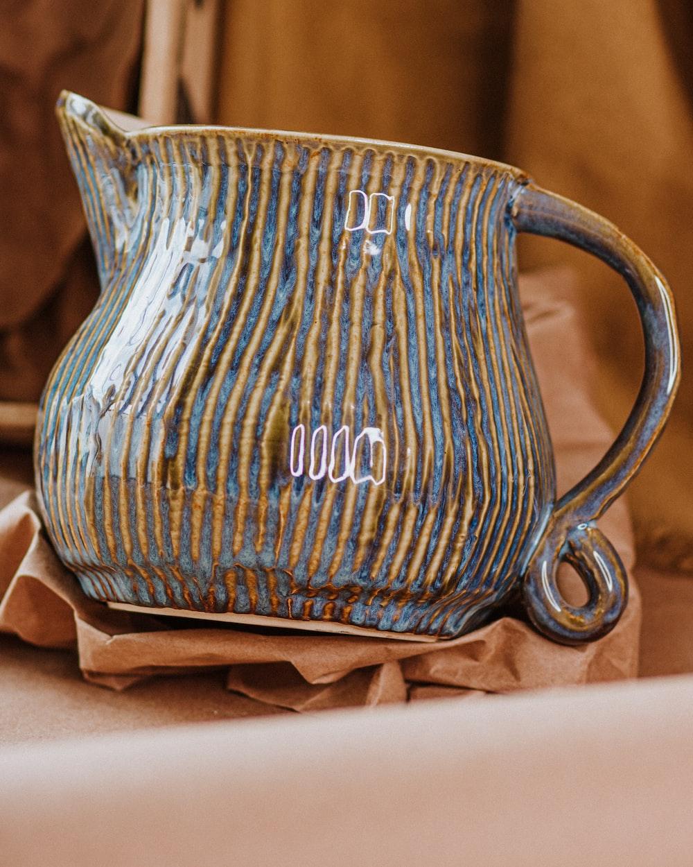 blue and brown ceramic vase