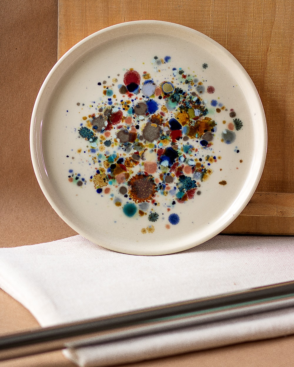 white ceramic bowl with assorted beads