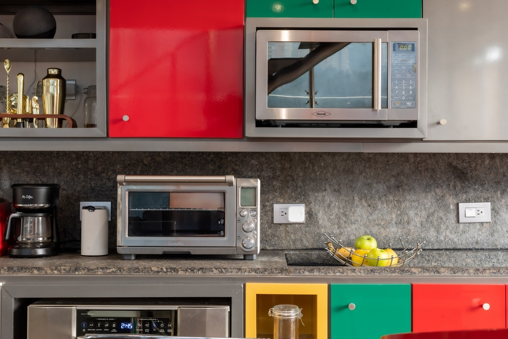silver microwave oven on black marble counter top