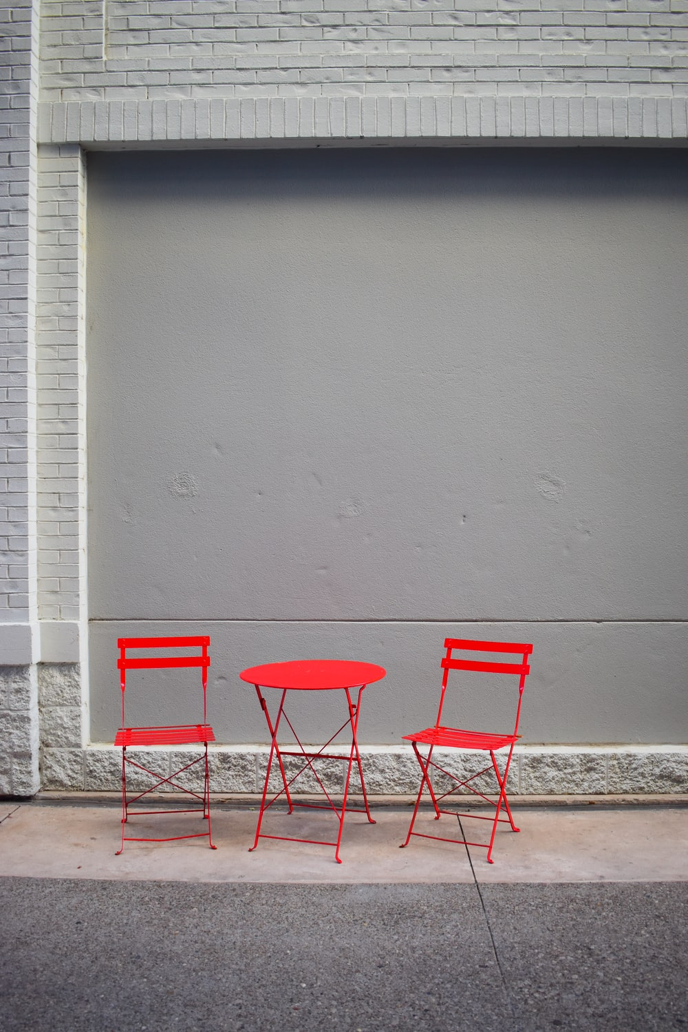 red chair beside white wall