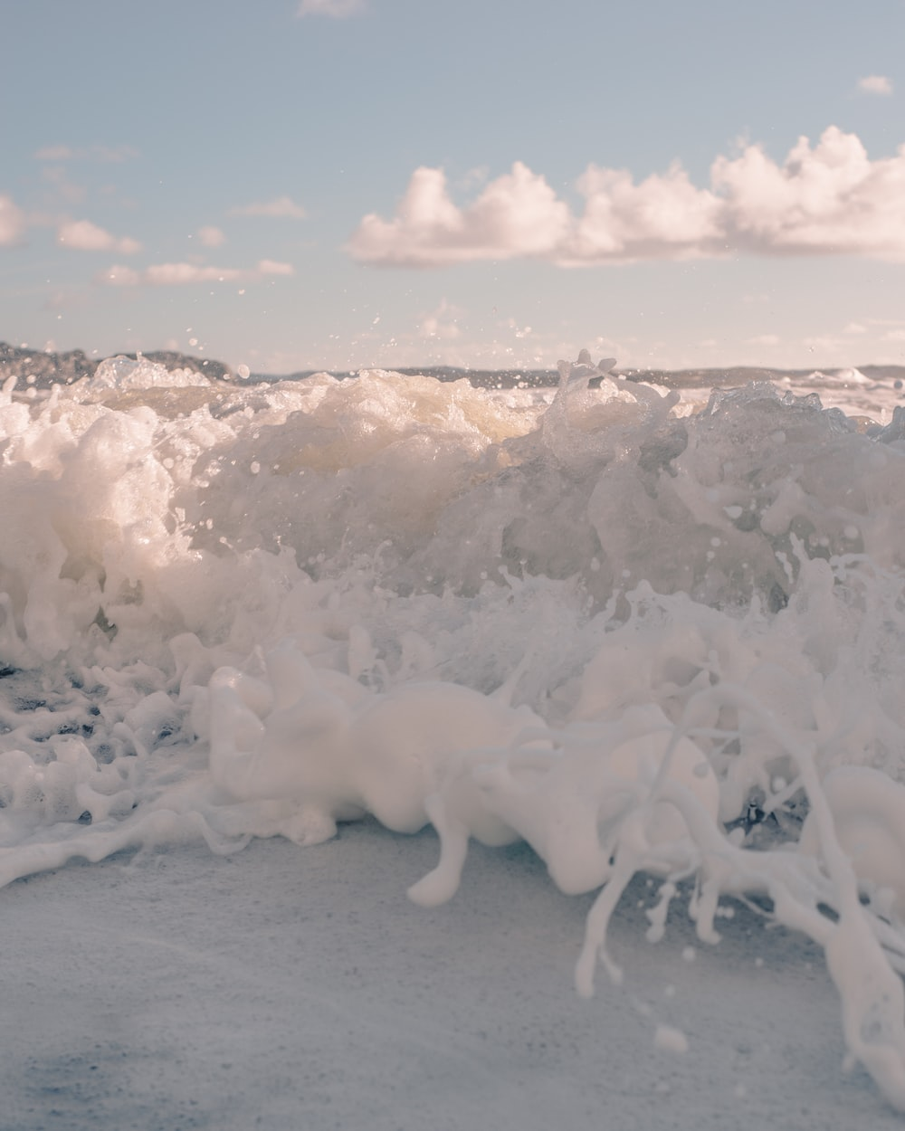 white ice on white sand during daytime