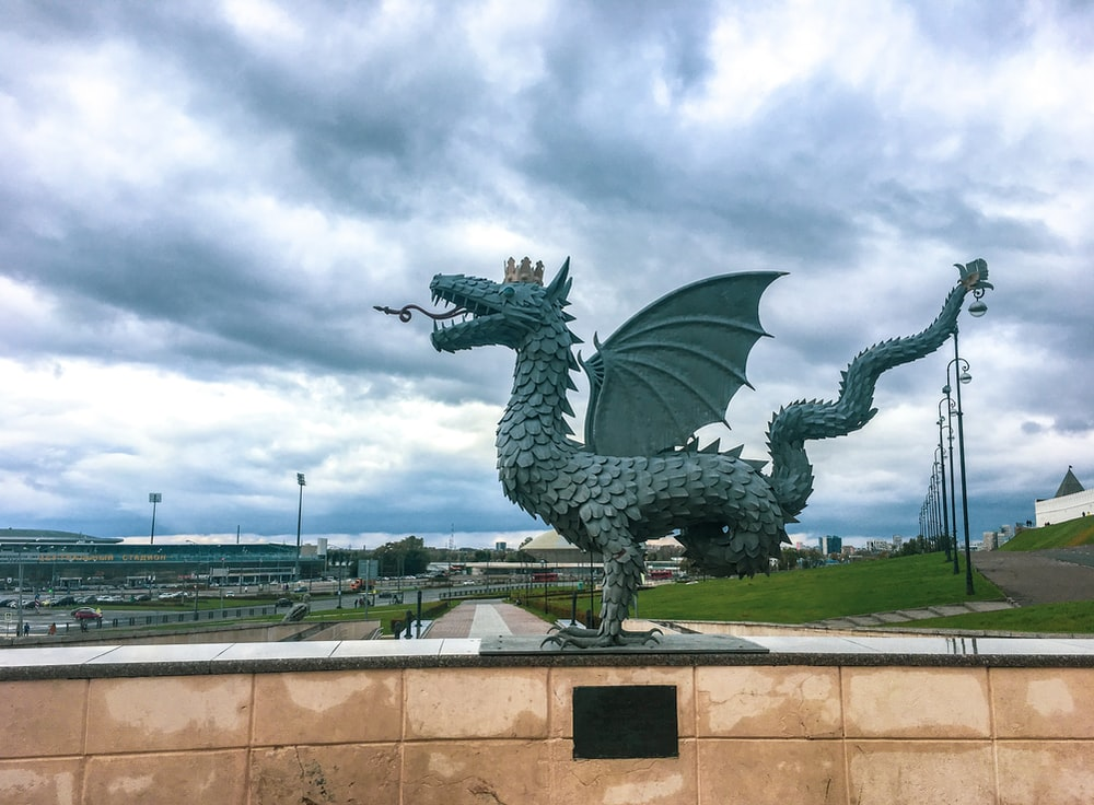 black dragon statue under cloudy sky during daytime