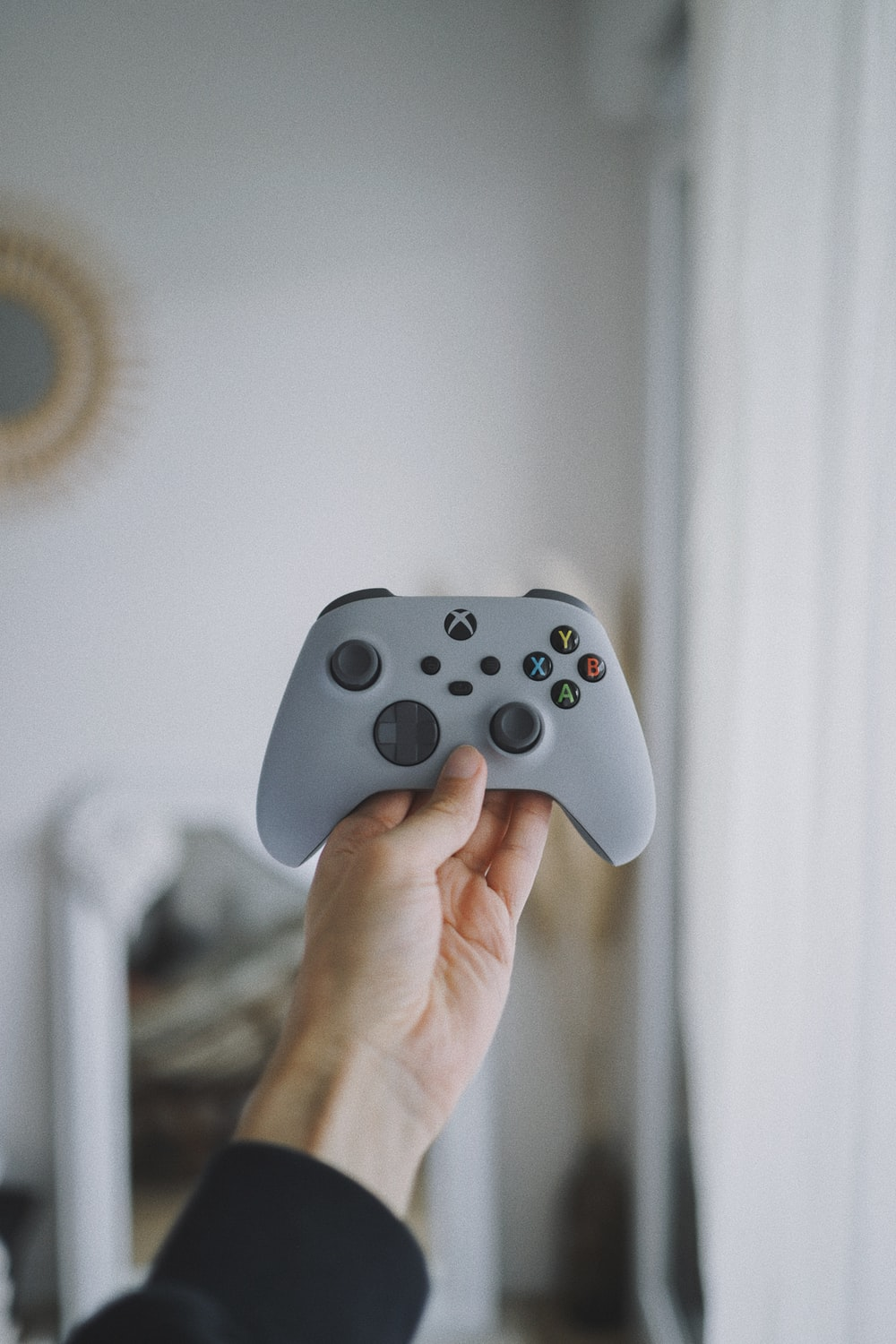 person holding white xbox one controller