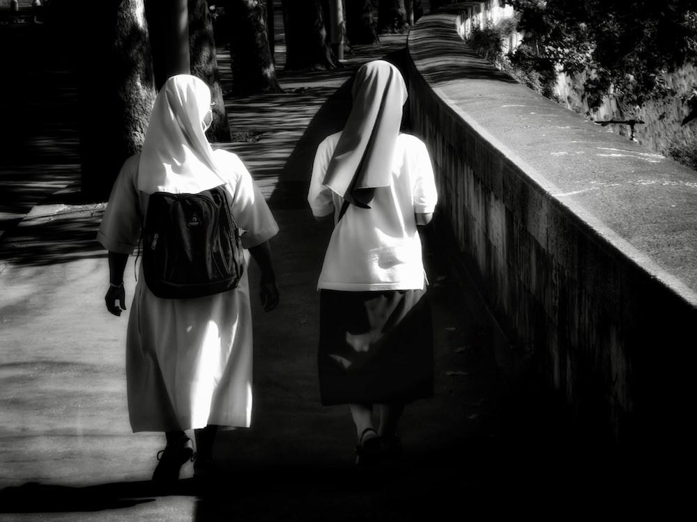 2 women walking on the bridge