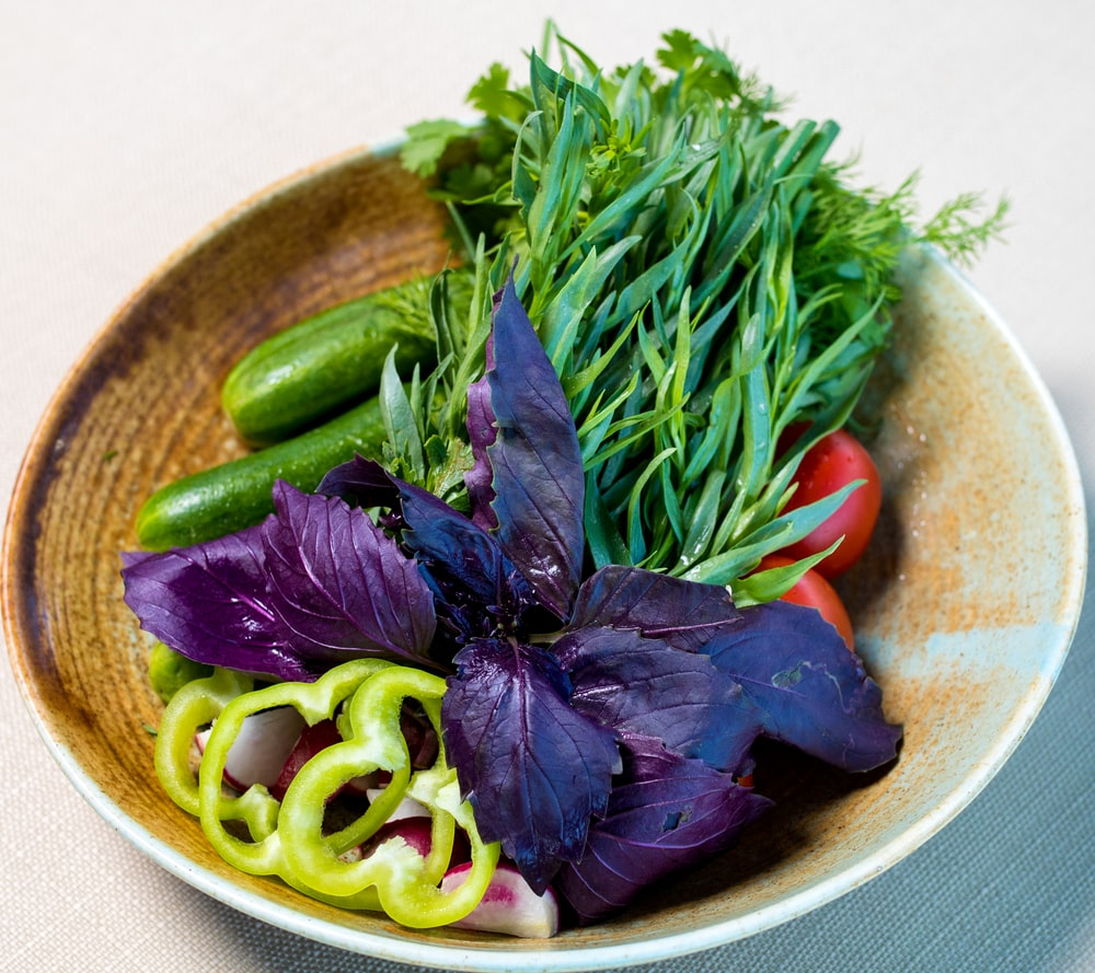 green vegetable on brown ceramic plate