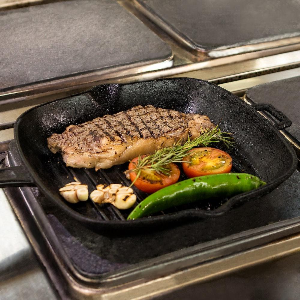 fried fish on black frying pan