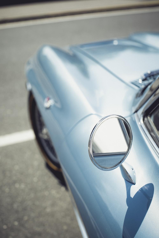 blue car with silver door handle