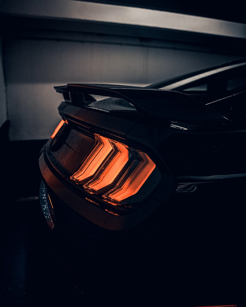 black car in a dark room