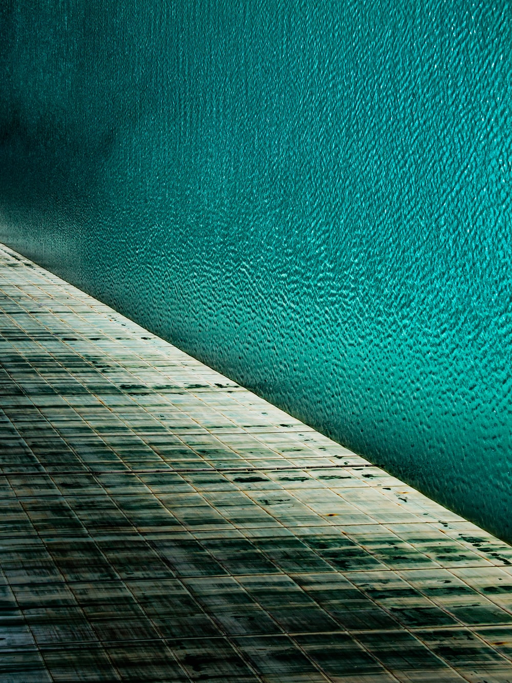 brown wooden dock over blue water