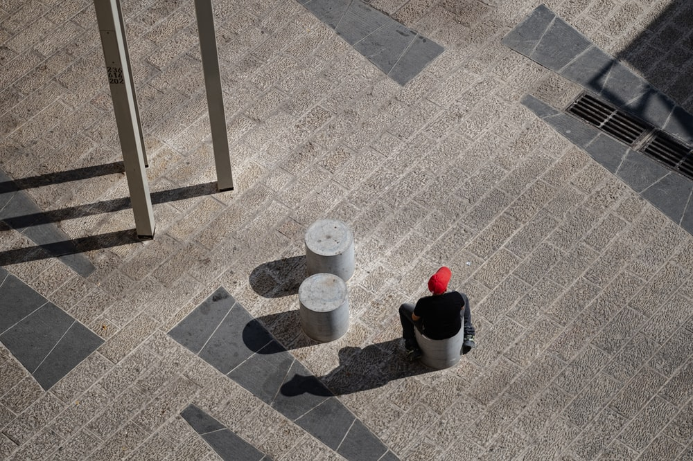 white and red plastic bucket on gray concrete floor