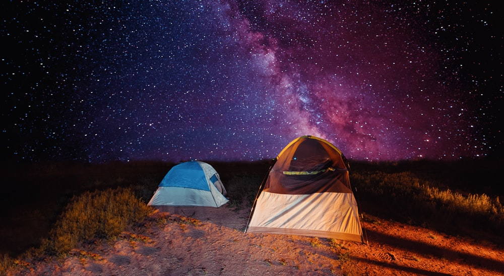 white and blue tent under starry night