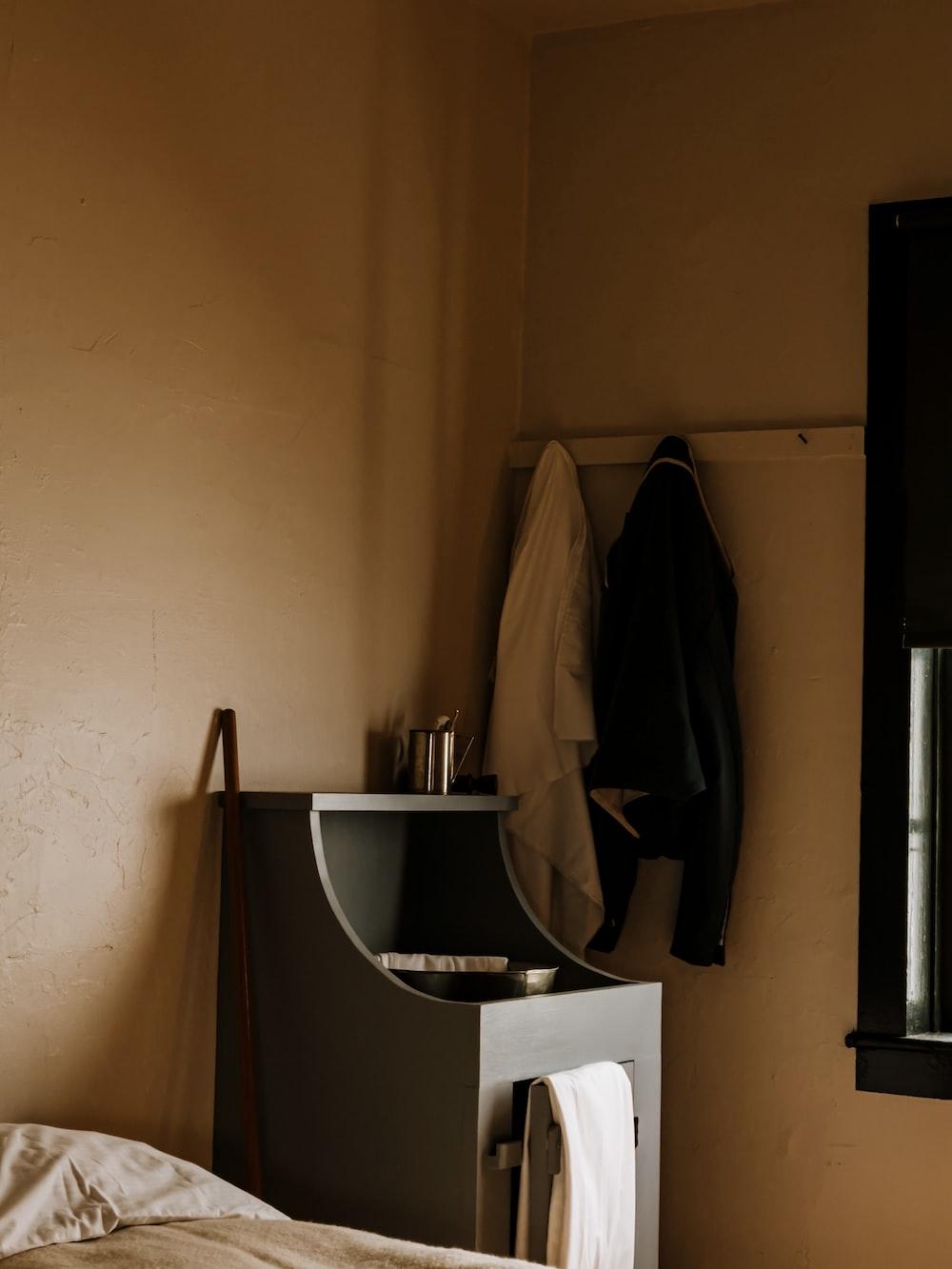 black coat hanging on wall