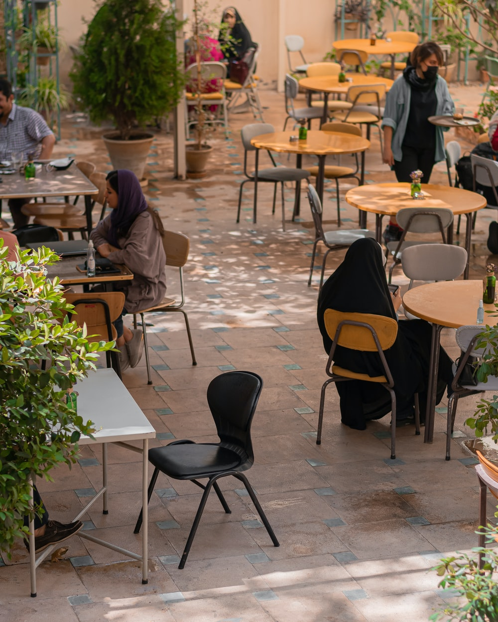people sitting on chairs near table during daytime