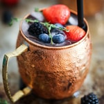raspberry and blueberry in brown ceramic mug