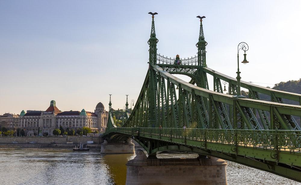 green metal bridge over river during daytime