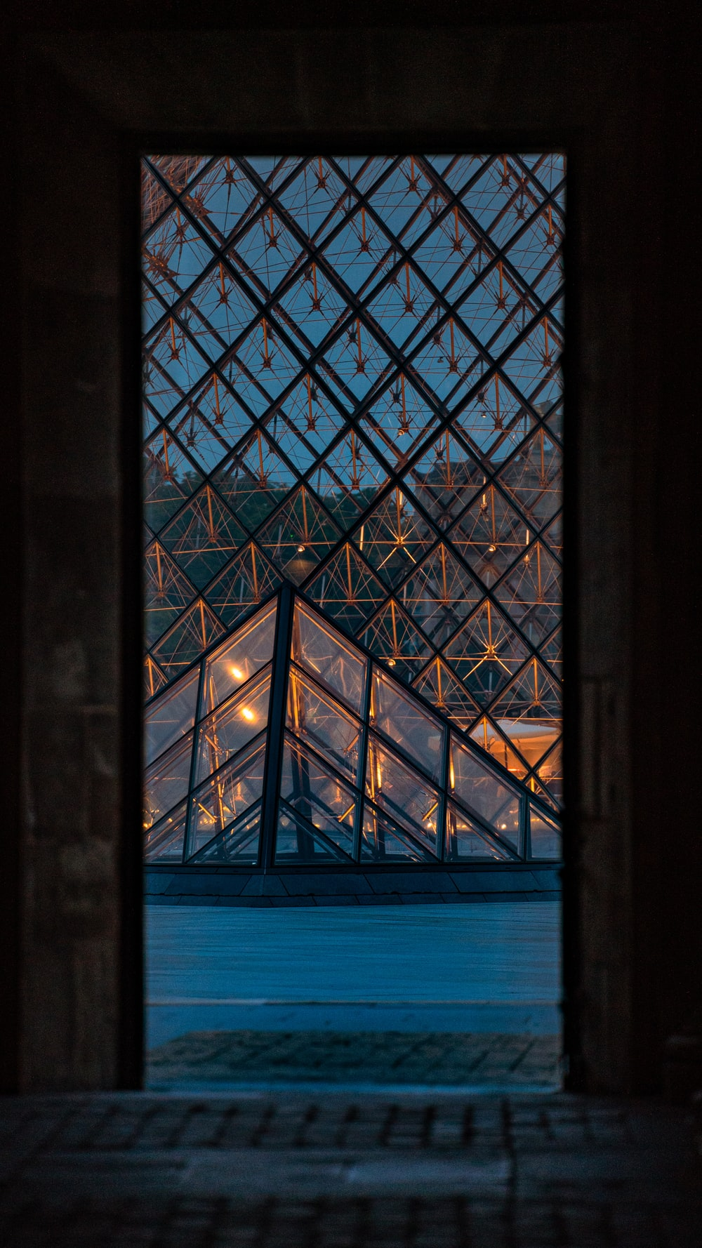 black framed glass window during night time