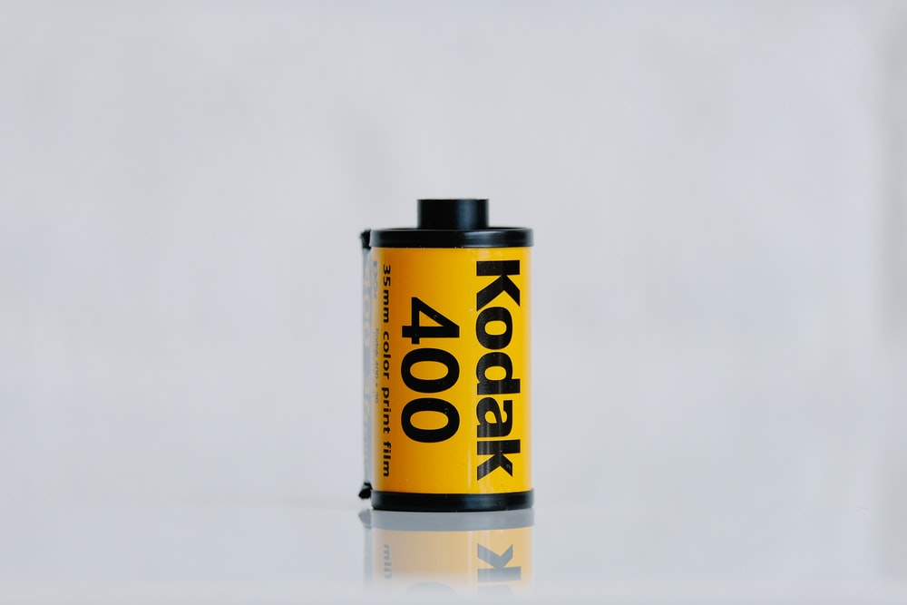 yellow and black labeled bottle