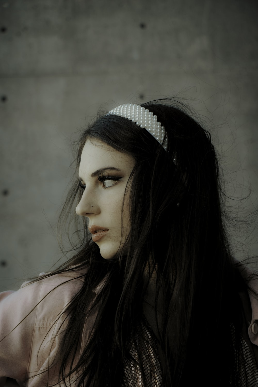 woman in white and black polka dot headband