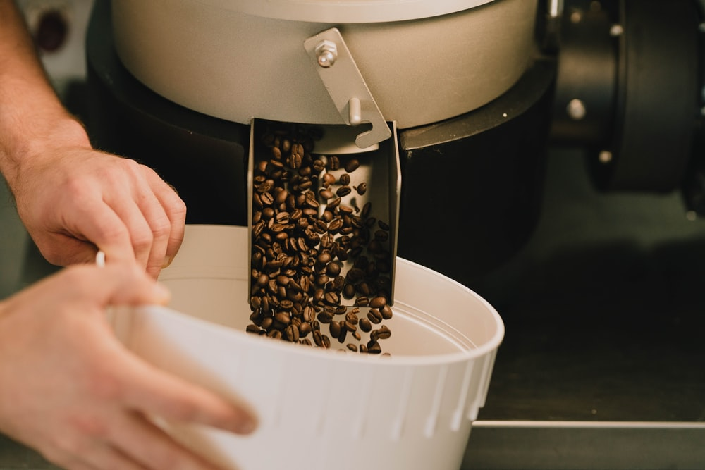 white plastic container with brown coffee beans