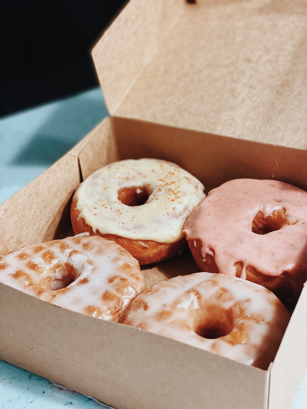 brown and white doughnuts in box