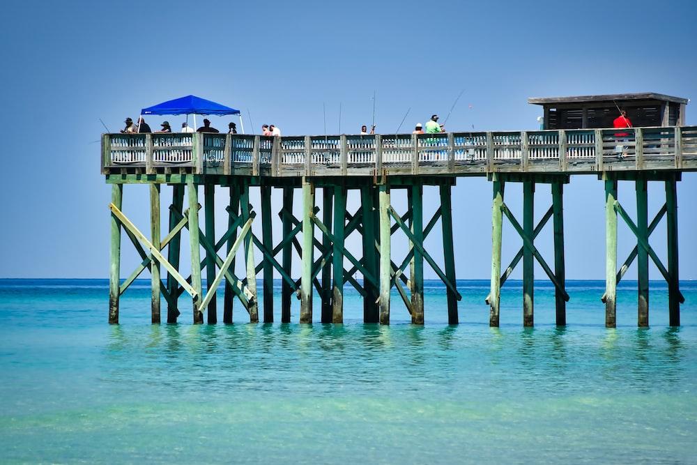 blue umbrella on wooden dock during daytime