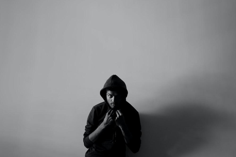 man in black hoodie and black knit cap