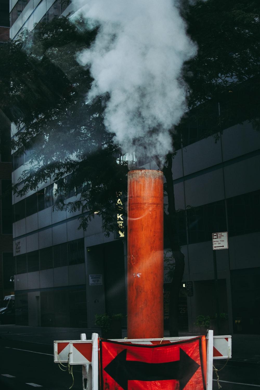 orange and black fire near building