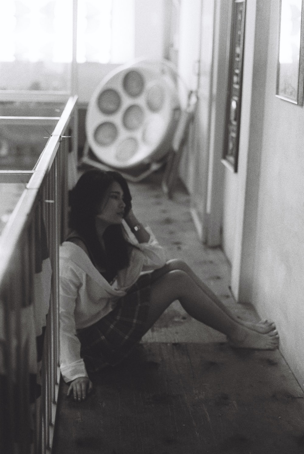 woman in white long sleeve shirt sitting on staircase