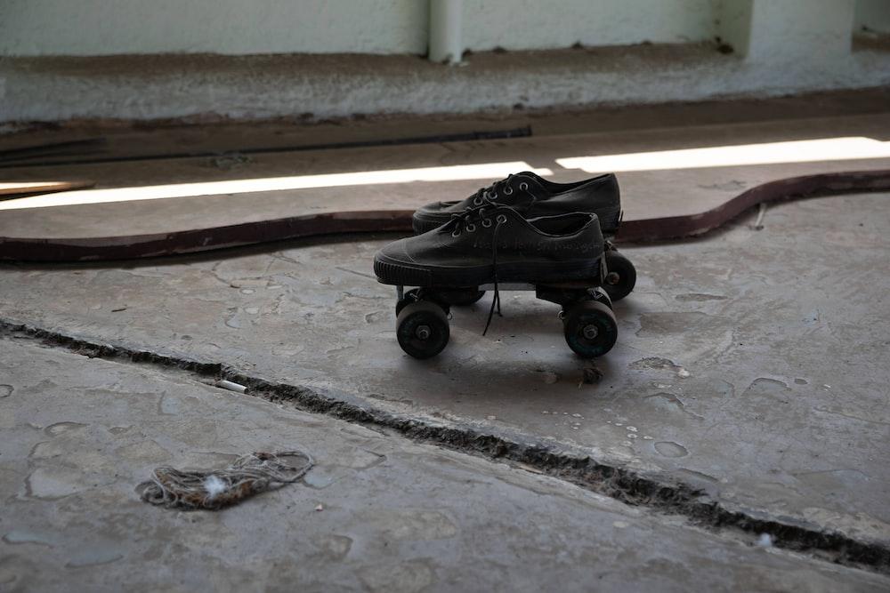 black stroller on gray concrete floor