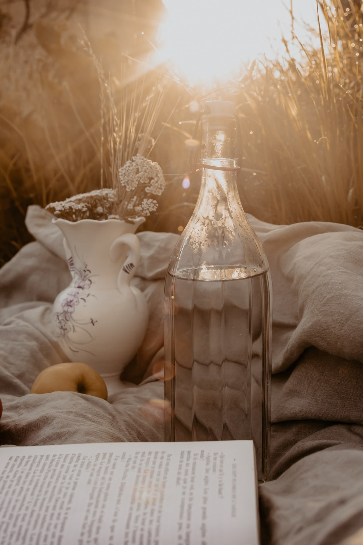 white ceramic vase on white textile