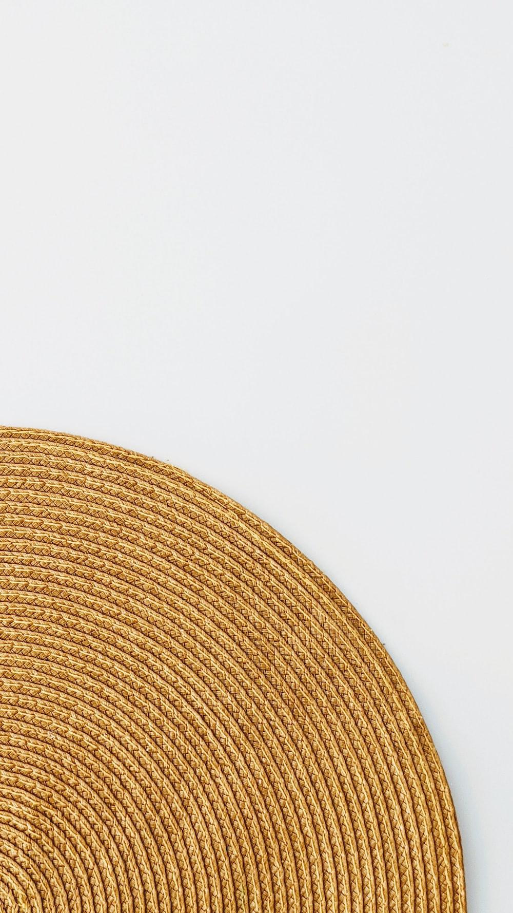 brown round textile on white surface