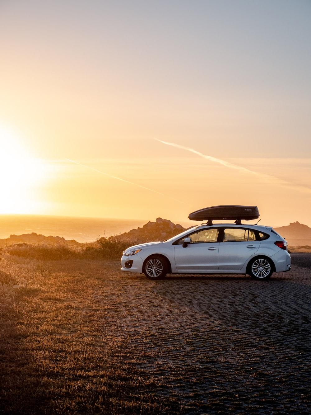 white chevrolet camaro on road during sunset