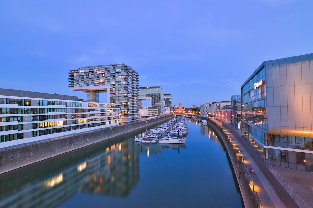 city skyline across river during daytime
