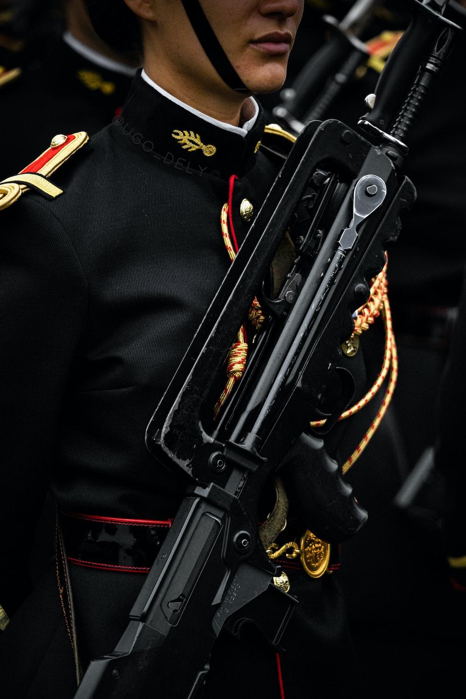 black rifle on black and gold coat
