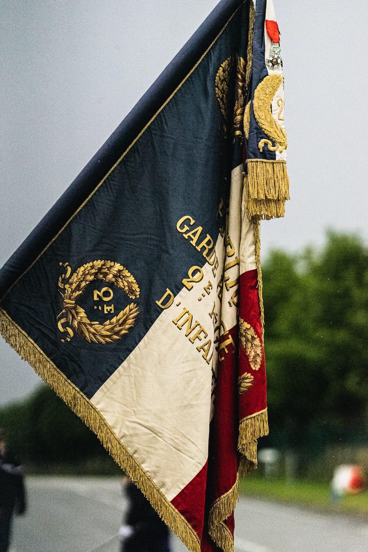 blue and white flag during daytime