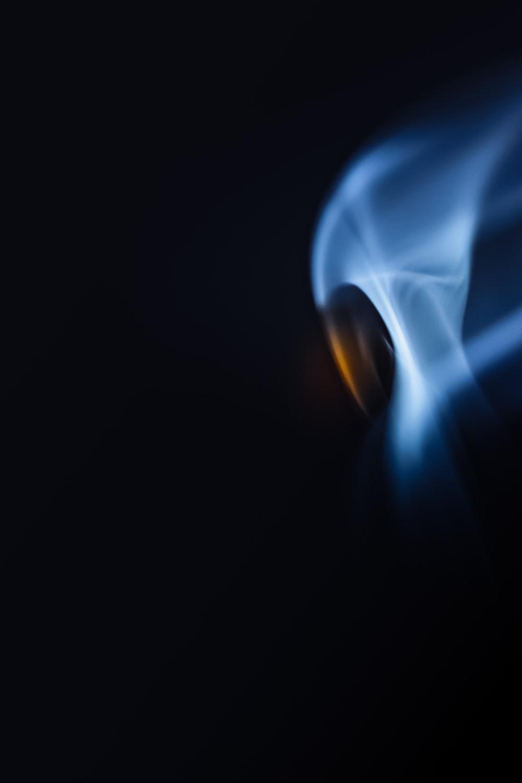 white smoke in a dark room