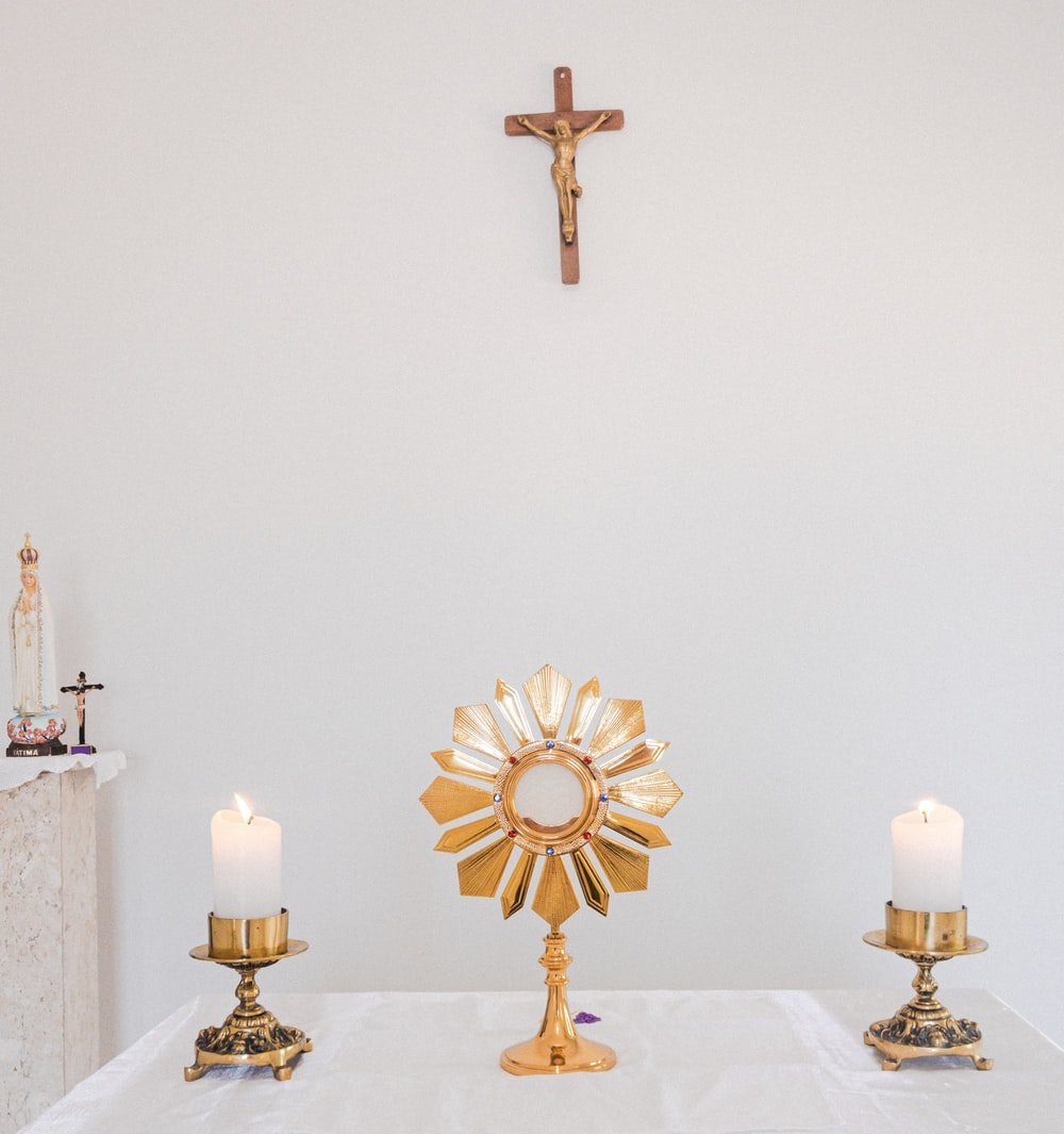 gold cross on white table