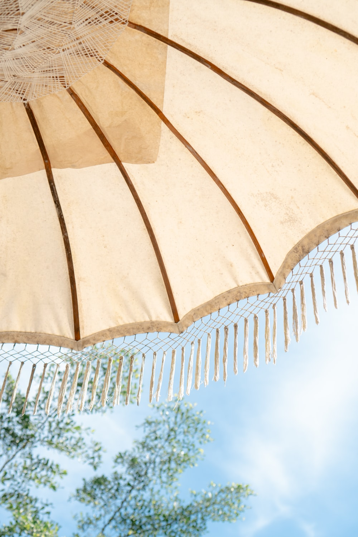 white and brown patio umbrella