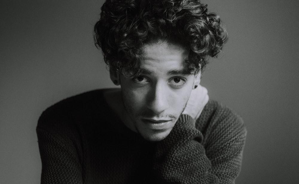 man in black knit sweater