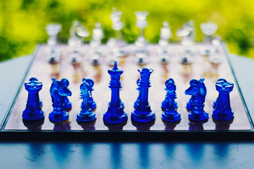 blue chess piece on black metal fence