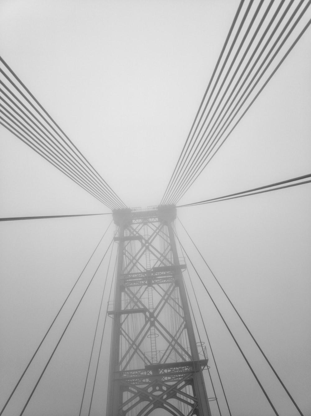 black cable bridge under white sky