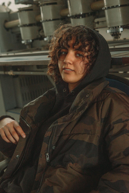 man in black and brown camouflage hoodie