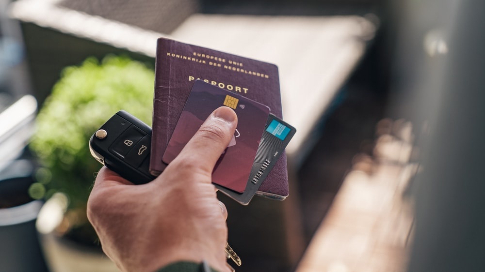 person holding black and brown book